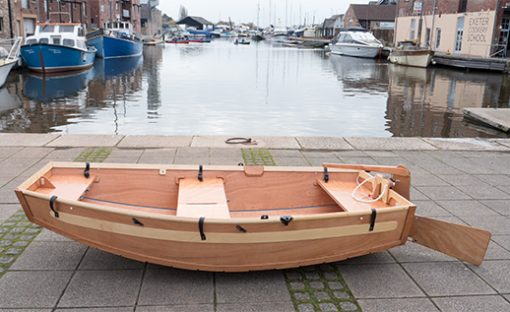 beautiful seahopper wooden folding boat with rudder and tiller on the Quay, Exeter