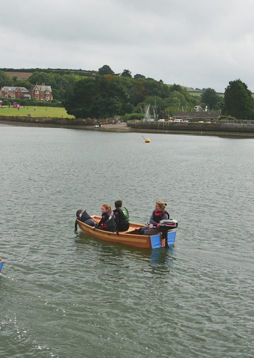 seahopper motor boat on the estuary with family