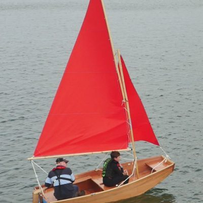 seahopper folding saiilng boat with red sails aerial view on the River Teign