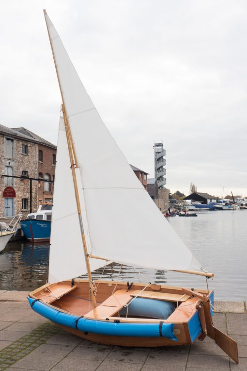 seahopper folding Kondor with blue PVC ends and white sails out of the water on Exeter Quay