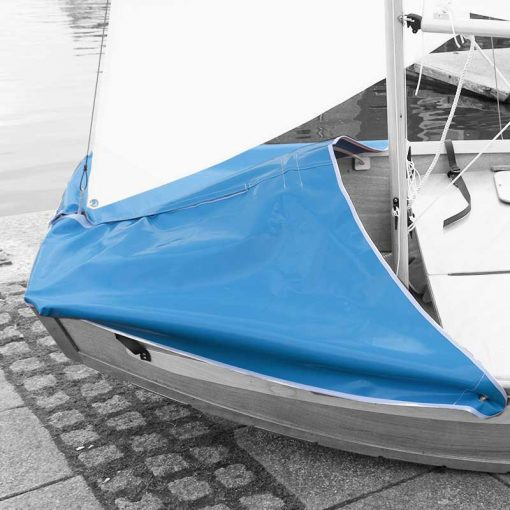 blue spray hood on the front of a wooden seahopper sail boat