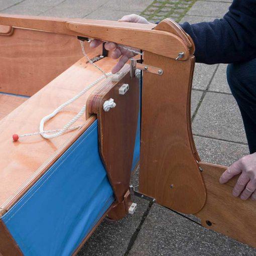 setting up the rudder and tiller on a seahopper wooden boat with blue PVC end