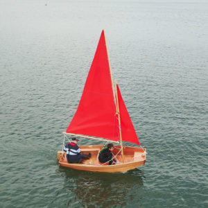 seahopper folding sail boat with red sails on the River Teign