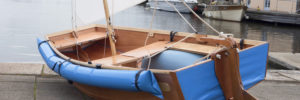 close up of seahopper folding sailing boat with blue PVC ends and blue dp air fenders