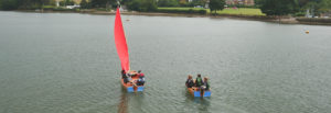 sail and motor wooden boats with blue PVC ends