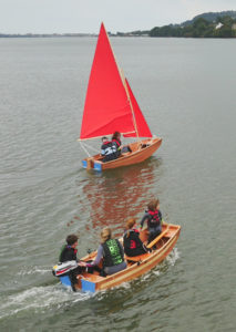 seahopper folding motor boat and folding sail boat with red sails