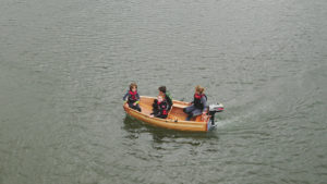aerial view of seahopper motor boat with family