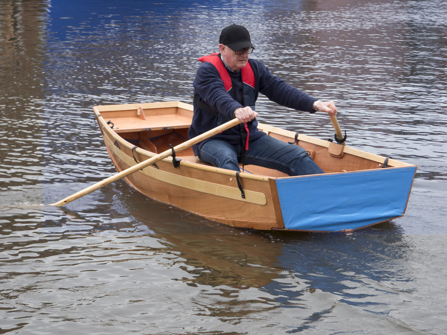 seahopper folding rowing boat with blue stern and oars at Exeter Quay