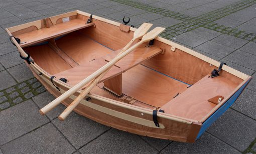 beautiful seahopper folding row boat made of wood with wooden oars on Exeter Quay