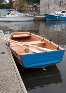 seahopper folding rowing boat with oars on the Quayside