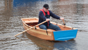 Seahopper with blue ends being rowed by seahopper owner Steven Burch