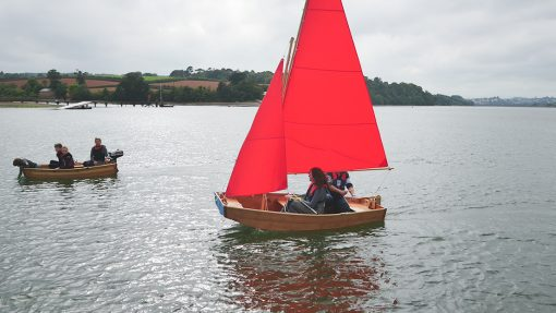 side view of seahopper sail and motor on the estuary
