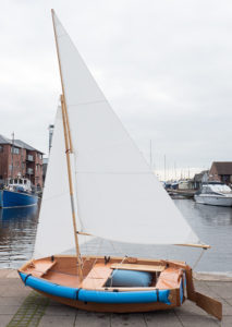 seahopper folding sail boat with blue PVC end, blue dual purpose air fenders and white sails on the Quay, Exeter