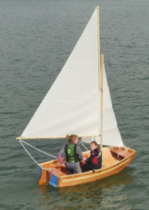 seahopper sailing boat with white sails aerial view on the River Teign