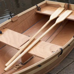 beautiful close up of a quality finish on a seahopper wooden sail boat with oars