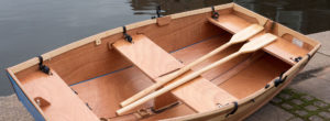 Seahopper wooden portable boat with oars and blue PVC ends