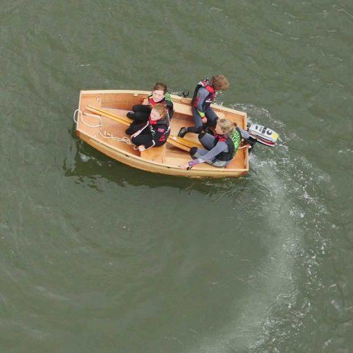 four passengers enjoying a motor around in a seahopper folding motor boat