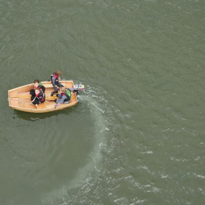 Aerial view of Seahopper wooden portable boat motoring on the river